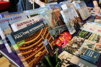 Study abroad brochures on a table at an event