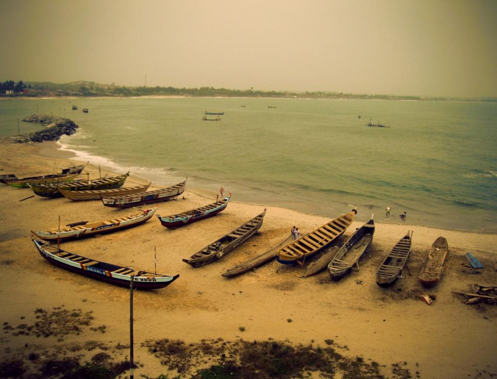 Boats on the shore near Elmina Castle in Ghana