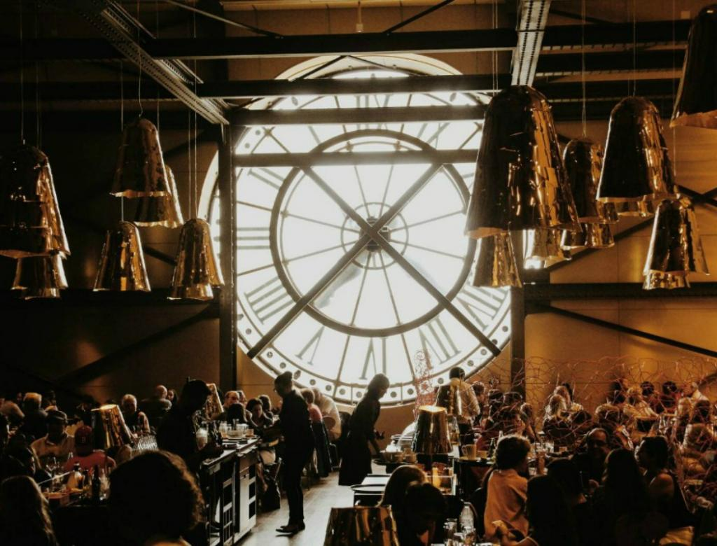 Inside a restaurant overlooking the clocks of Musee d'Orsay.