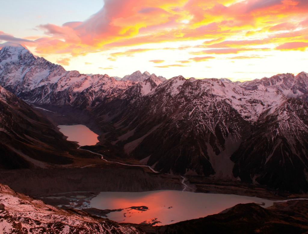 Sunrise creates a colorful sky in the Southern Alps