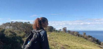 Screen Shot of woman looking over landscape from Asia's video about Australia