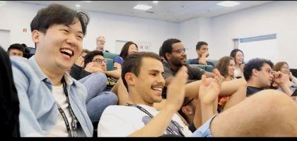 Still of students laughing in classroom