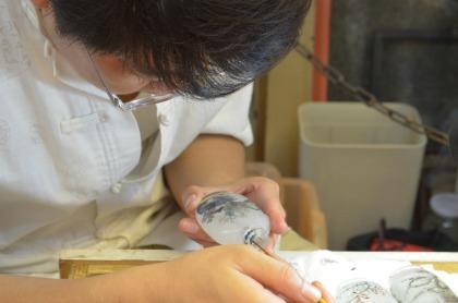 Artist in Shanghai working diligently.