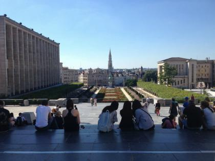 Tourists relax and enjoy the view in Brussels
