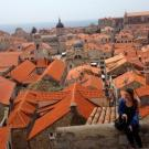 Student looking over bridge at terra cotta rooftops in Czech Republic